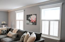 light gray walls dark gray couch i like the molding on the