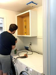 how to install base cabinets in laundry room 206 laundry room update and cabinets create enjoy