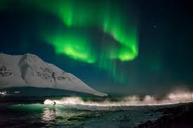 iceland in january northern lights surfing iceland beneath the northern lights brace for the storm