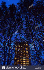 building at with trees and lights tilted focus stock photo