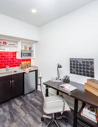 gather oxford university of mississippi student apartments kitchenette with stainless steel appliances study desk