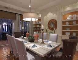 traditional dining room with built in bookshelf by marc michaels