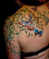 asian butterfly phoenix and flowers tattoos behind shoulder photo