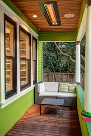 exterior design ipe decking and wood siding in green paint color