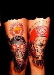 feminine skull tattoo on both legs photos pictures and sketches
