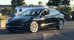 first photo of tesla model 3 production car musk gifted rights to