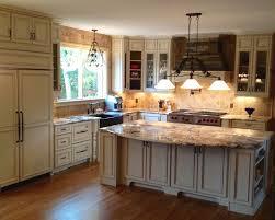 pioneer cabinets fairfax door in ivory with khaki glaze granite