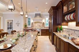 a large kitchen with dark brown cabinets cream colored tile