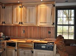 kitchen kitchen backsplash with oak cabinets and white appliances
