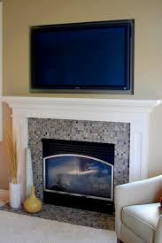 black fireplace with glass on the middle combined with gray and