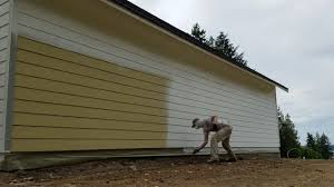 spray painting hardi plank siding with miller paint acry lite