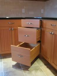 kitchen corner cabinet ideas instead of a lazy susan or blind pullout how about these angle