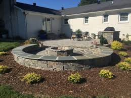 Backyard Brick Patio Design With Grill Station Seating Wall And by Paver Patio With A Grill Station Bubbling Rock Sitting Wall And