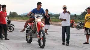 125 motocross bike drag racing honda crf450 vs honda 125cc moped vs motocross youtube