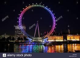 millennium wheel in illuminated in rainbow lights