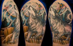 wolf on a rock on the background of the moon wolf tattoos