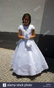 in first holy communion dress in madeira stock photo royalty
