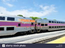 Commuter Rail by Commuter Rail Train Double Decker Passenger Cars On Railroad