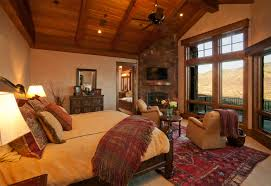 amazing romantic bedroom design with fire place and mountain view