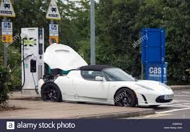 tesla supercar tesla roadster electric car supercar on charge at heston services
