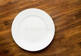 plate table top empty white plate on wooden table top view stock photo image of