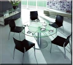 round glass dining tables on black metal base added by white