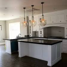 kitchen lighting cluster of pendant lights countertop with stove