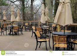 Umbrella For Patio Table by Peaceful Scene Of Tables And Chairs With Tied Umbrellas On Outdoor