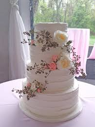 buttercream textured wedding cake with fresh flowers by gateau