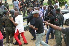 rotimi amaechi storms police station to release arrested inec