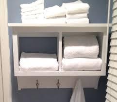 Shelves For Towels In Bathrooms Bathroom Shelf With Towel Rack Sebastianwaldejer