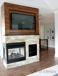 stone ledgestone 3 sided fireplace with wood shiplap that is