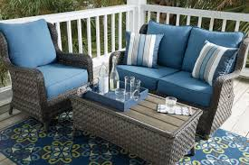 Patio Loveseat Glider Ashley Abbots Court Loveseat Glider With Table Chair