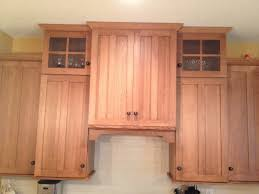 shaker style range hood cabinet with arched valance above white