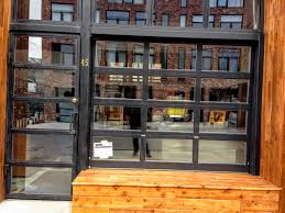 Brooklyn Home Decor Black Metal And Glass Garage Door For Freehold Coffee In