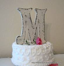 m cake topper etsy of the week cake toppers hitched events llc