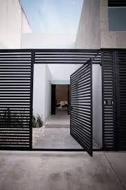 interior unique black shutter in the entrance of the cereza house