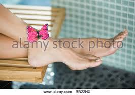 butterfly on human leg up stock photo royalty free image