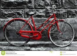 retro vintage red bike on black and white wall stock photo