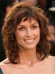 medium length curly hairstyles for womens medium length layered