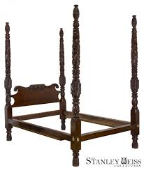 a magnificent highly carved classical mahogany 4 poster bed