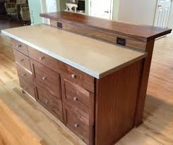 custom kitchen island with slab bar top by saw tooth designs llc