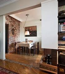 decorating a small dining room with wall art and brick walls