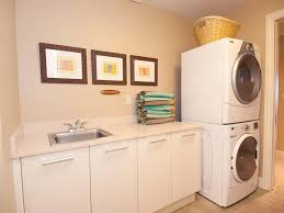 Laundry Room Storage Between Washer And Dryer by Laundry Room Modern Laundry Room Design Ideas With Grey Stainless