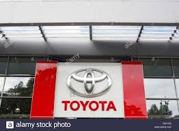 t0yta car a big toyota logo on the side of a toyota car dealership stock