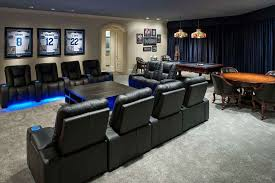 Media Game Room - modern game room with game table by wesley wayne interiors llc
