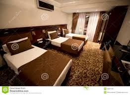 small hotel room with three single beds stock photography image