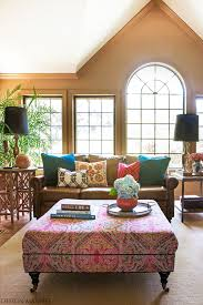 brown leather sofa family room eclectic with global ottoman