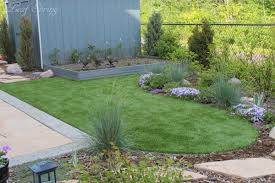 backyard retreat with synthetic lawn aluminum edging vegetable