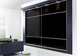 bedroom glass sliding wardrobe door in black color with white